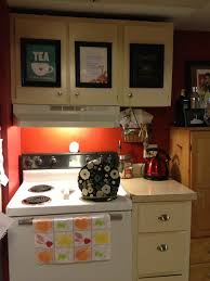 picture frames on kitchen cabinet doors add character when some is