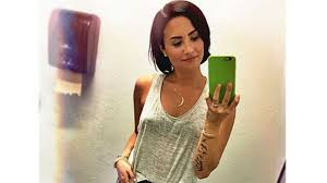 demi lovato covers up u0027vagina u0027 tattoo with huge rose celebrity