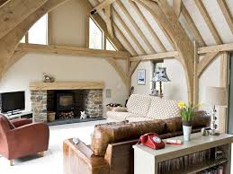 exposed oak frame living space with log burner