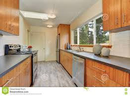 narrow kitchen room with long grey counters stock photo image
