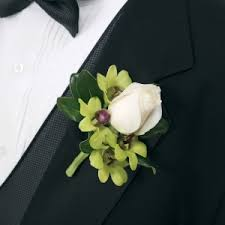 orchid boutonniere green and white boutonniere wedding planning
