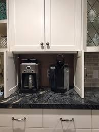 cabinet doors that slide back coffee cabinet hideaway with slide back doors transitional