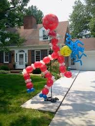 balloon delivery grand rapids mi big white balloon dog column balloon decor dog column