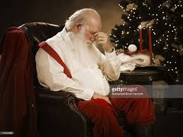 profile of santa claus holding a long list stock photo getty images