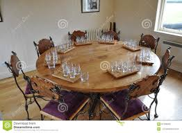 handmade chairs and round dining room table with degustation sets