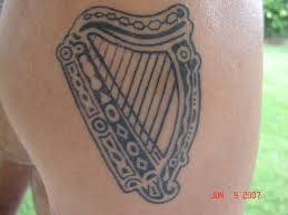 guinness label harp tattoo