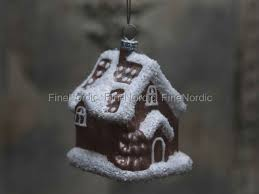 chic antique gingerbread house with snow glitter antique rose