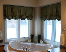 elegant kitchen window decorated with large cornice and brown