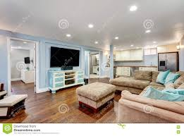 pastel blue walls in basement living room interior stock photo