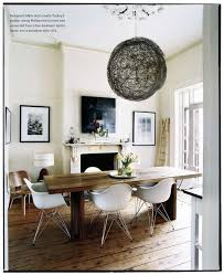 dining table in front of fireplace dining room with farmhouse table and white mid century chairs