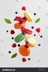 french macarons fresh berries colorful macarons stock photo