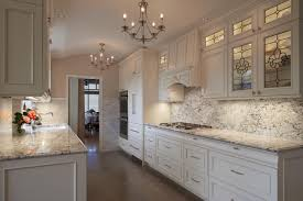 white cabinets chairs and marble countertop gray electric range