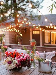 String Of Flower Lights by How To Hang Outdoor String Lights Domestic Imperfection