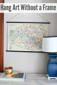 how to hang canvas art without frame want a simple way to hang a large scale map or poster here s how