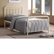 white iron bed frame with striped headboard and footboard