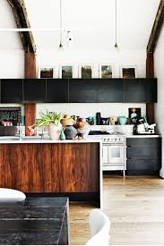 mixing timber with black cupboard gives a warehouse edge