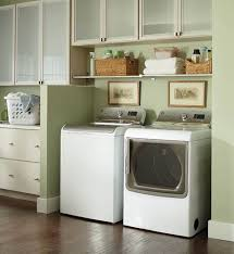 minimalist design for laundry room featuring white washing machine