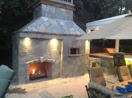 interior outdoor fireplace and pizza oven bathroom vent