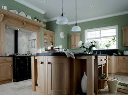 curved kitchen design with dark granite worktop and hanging lamps