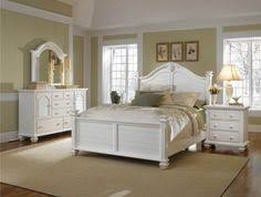 seabrooke queen panel bed with arched louvered headboard by