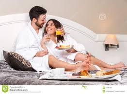 young couple on honeymoon in hotel room stock photo image 52687780