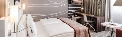 Schlafzimmer Bett M El Martin München Hotels Zentrum Holiday Inn Munich City Centre Deutschland