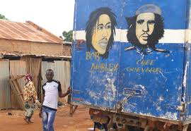 file young man poses with bob marley che e guevara mural on back file young man poses with bob marley che e guevara mural on