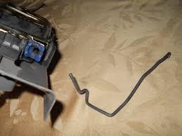 nissan altima 2005 driver side door get door handle rod back into the seat on the actuator plastic