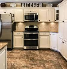 best paint to redo kitchen cabinets bye bye honey oak kitchen cabinets hello brighter kitchen