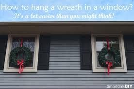 window wreaths how to hang a wreath in a window