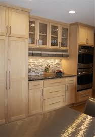 black granite countertops with maple cabinets in