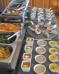 and seek to show hospitality thanksgiving dinner buffet set up on
