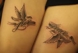 matching turtle dove tattoos