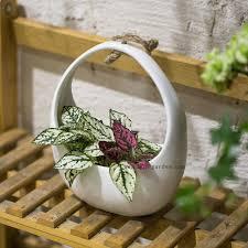small white round hanging ceramic flower pot basket vertical