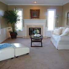 sherwin williams latte but picture the fireplace with black rock