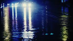 it s raining raindrops colorful traffic lights at