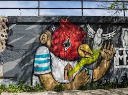 a neighborhood guide to discovering chicago street art bird masks designed by street artist sentrock