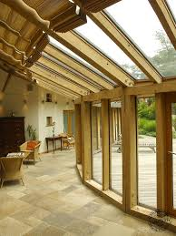 contemporary curved oak frame conservatory with roof glazing by