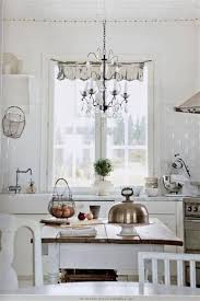 Chandelier Lighting Fixtures by Shabby Chic White Kitchen With Chandelier Lighting Fixtures