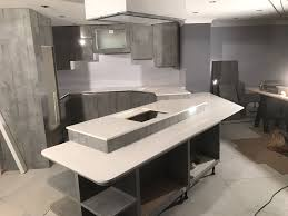 bianco stella futuristic kitchen with white starlight quartz