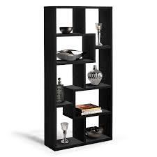 high black wooden bookcase with random size shelves placed on the