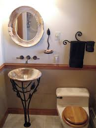 classic bathroom with solid wrought iron pedestal stand sink and