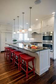 kitchen peninsula with seating on both sides pendant light double