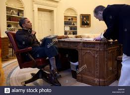 president barack obama talks on the phone from inside the stock