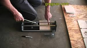 Cutter For Laminate Flooring How To Use A Tile Cutter Youtube