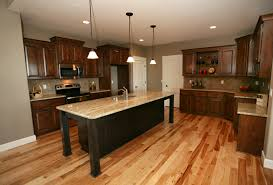 what color flooring goes with alder cabinets affordable custom cabinets showroom