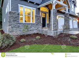 front covered porch design with stone columns stock photo image