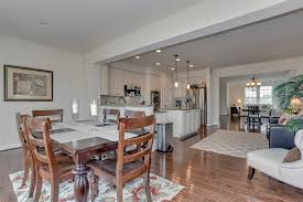 dining room with hardwood floors carpet in frederick md