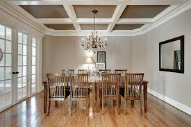 Mission Style Dining Room Tables - traditional dining room with crown molding by dumont decor