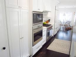 white kitchen designs with dark floor white bar stool with back